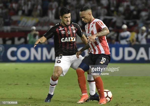 Jarlan Barrera of Junior struggles for the ball with Marcinho of Paranaenseduring the first leg of the final of Copa Sudamericana 2018 between Junior...