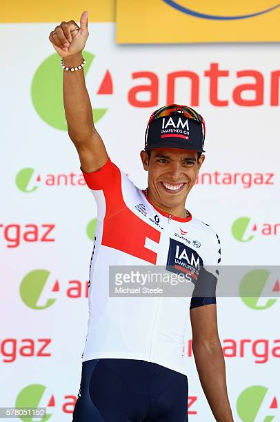 Jarlinson Pantano of Colombia and IAM Cycling celebrates receiving the most competitive rider of the stage following the 184.5km stage seventeen of...