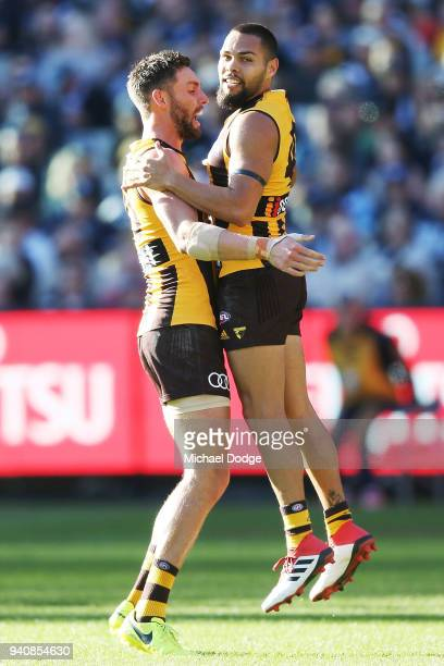 Jarman Impey and Jack Gunston of the Hawks celebrate a goal during the round two AFL match between the Geelong Cats and the Hawthorn Hawks at...