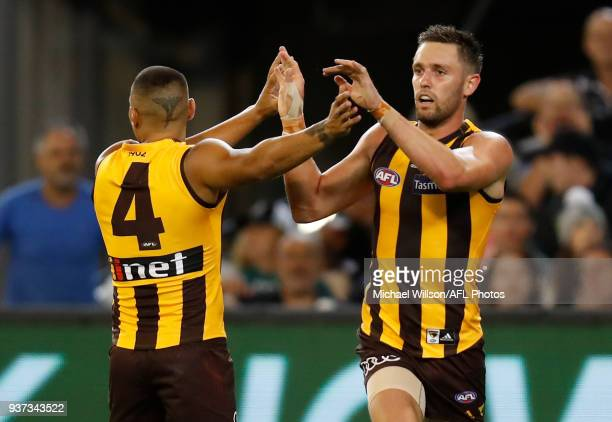 Jarman Impey and Jack Gunston of the Hawks celebrate during the 2018 AFL round 01 match between the Hawthorn Hawks and the Collingwood Magpies at the...