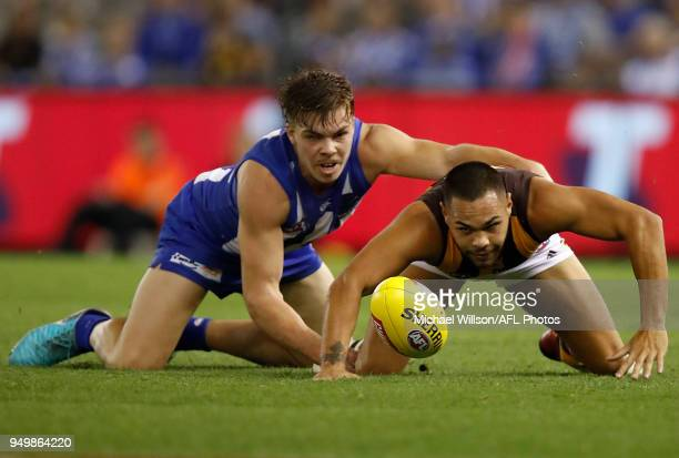 Jarman Impey of the Hawks and Cameron Zurhaar of the Kangaroos in action during the 2018 AFL round five match between the North Melbourne Kangaroos...
