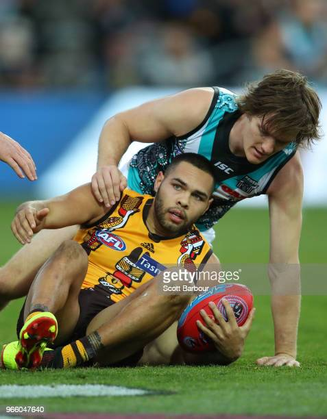 Jarman Impey of the Hawks and Jared Polec of the Power compete for the ball during the round 11 AFL match between the Hawthorn Hawks and the Port...