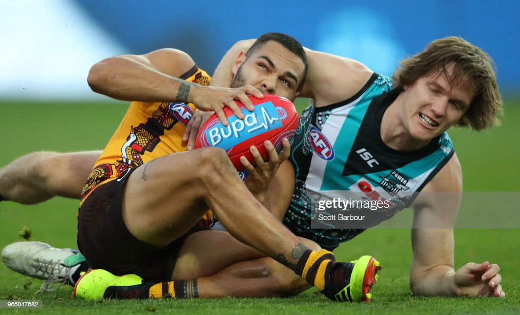 Jarman Impey of the Hawks and Jared Polec of the Power compete for the ball during the round 11 AFL match between the Hawthorn Hawks and the Port Adelaide Power at University of Tasmania Stadium on June 2, 2018 in Launceston, Australia.