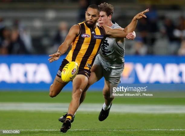 Jarman Impey of the Hawks and Paddy Dow of the Blues in action during the AFL 2018 JLT Community Series match between the Hawthorn Haws and the...