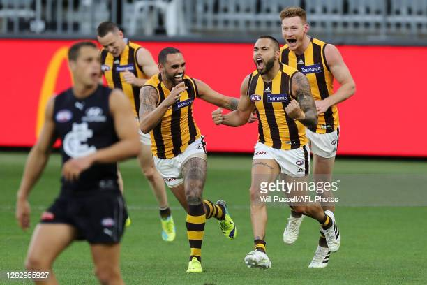 Jarman Impey of the Hawks celebrates after scoring a goal during the round nine AFL match between the Carlton Blues and the Hawthorn Hawks at Optus...