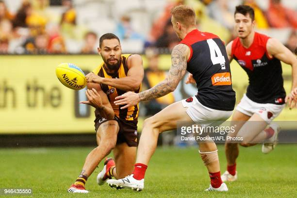 Jarman Impey of the Hawks handpasses the ball during the round four AFL match between the Hawthorn Hawks and the Melbourne Demons at Melbourne...