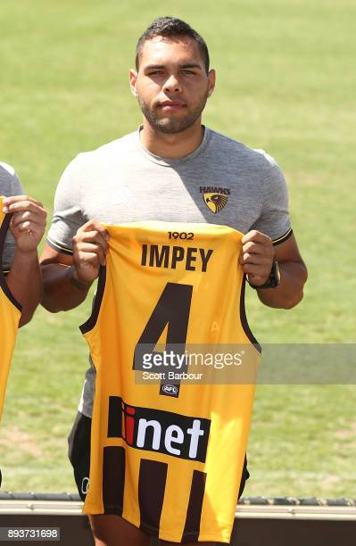 Jarman Impey of the Hawks holds his new guernsey number at the jumper number reveal during a Hawthorn Hawks AFL training session at Waverley Park on...