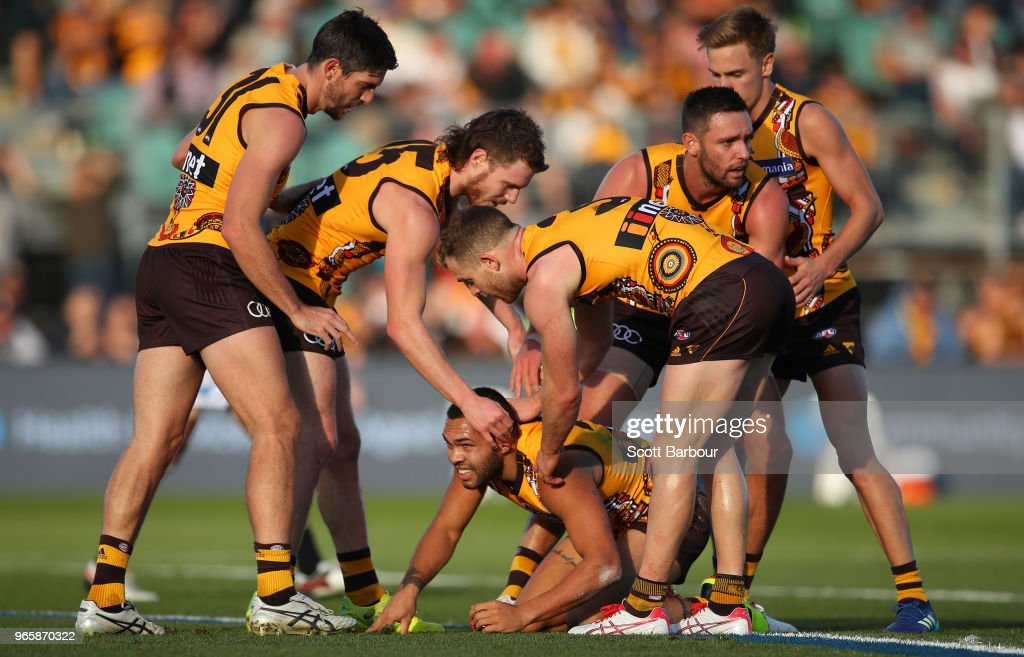 Jarman Impey of the Hawks is congratulated by his teammates after kicking a goal during the round 11 AFL match between the Hawthorn Hawks and the Port Adelaide Power at University of Tasmania Stadium on June 2, 2018 in Launceston, Australia.