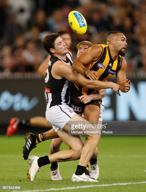 Jarman Impey of the Hawks is tackled by Jack Crisp of the Magpies during the 2018 AFL round 01 match between the Hawthorn Hawks and the Collingwood...