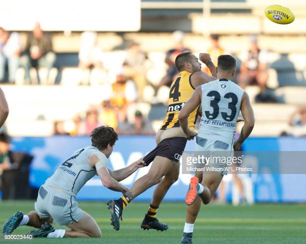 Jarman Impey of the Hawks is tackled by Paddy Dow of the Blues during the AFL 2018 JLT Community Series match between the Hawthorn Haws and the...
