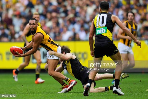 Jarman Impey of the Hawks is tackled during the round three AFL match between the Richmond Tigers and the Hawthorn Hawks at Melbourne Cricket Ground...
