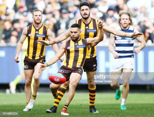 Jarman Impey of the Hawks kicks the ball during the round 21 AFL match between the Hawthorn Hawks and the Geelong Cats at Melbourne Cricket Ground on...