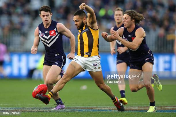 Jarman Impey of the Hawks kicks the ball off the ground during the round 19 AFL match between the Fremantle Dockers and the Hawthorn Hawks at Optus...