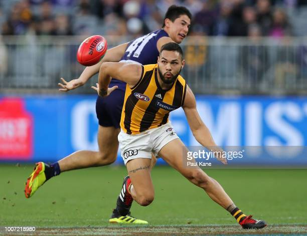 Jarman Impey of the Hawks looks to win possession of the ball during the round 19 AFL match between the Fremantle Dockers and the Hawthorn Hawks at...