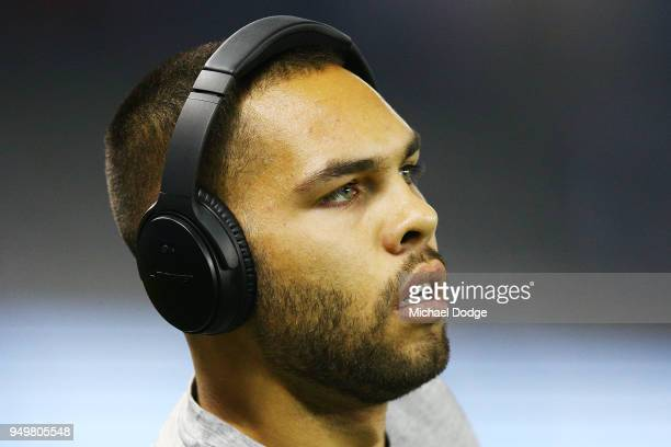 Jarman Impey of the Hawks looks upfield with his headphones during the round five AFL match between the North Melbourne Kangaroos and the Hawthorn...