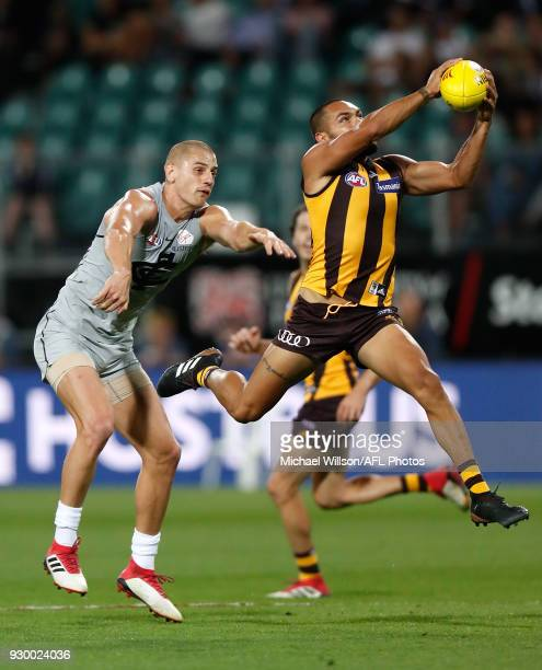 Jarman Impey of the Hawks marks the ball ahead of Liam Jones of the Blues during the AFL 2018 JLT Community Series match between the Hawthorn Haws...