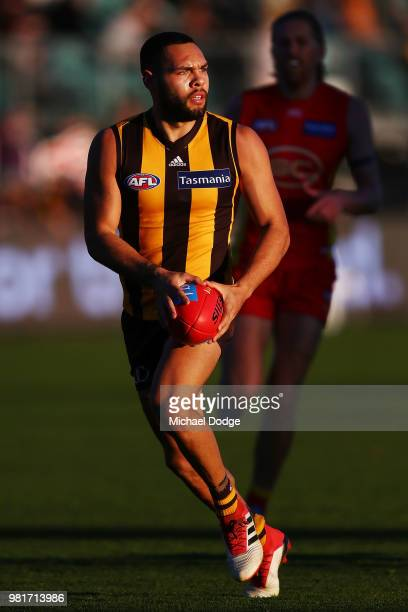 Jarman Impey of the Hawks runs with the ball during the round 14 AFL match between the Hawthorn Hawks and the Gold Coast Suns at University of...