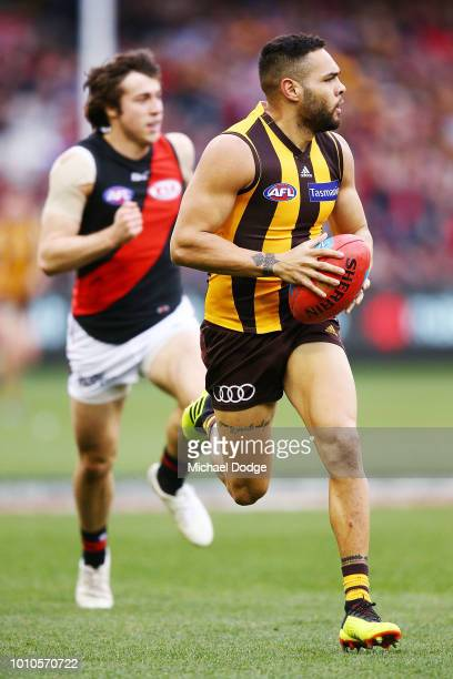 Jarman Impey of the Hawks runs with the ball during the round 20 AFL match between the Hawthorn Hawks and the Essendon Bombers at Melbourne Cricket...