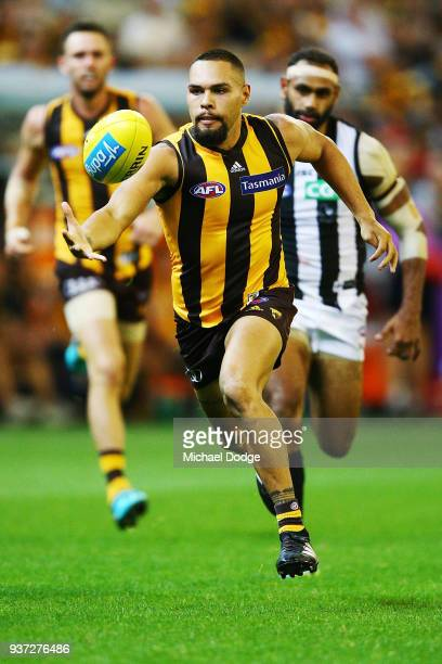 Jarman Impey of the Hawks runs with the ball from Travis Varcoe of the Magpies during the round one AFL match between the Hawthorn Hawks and the...