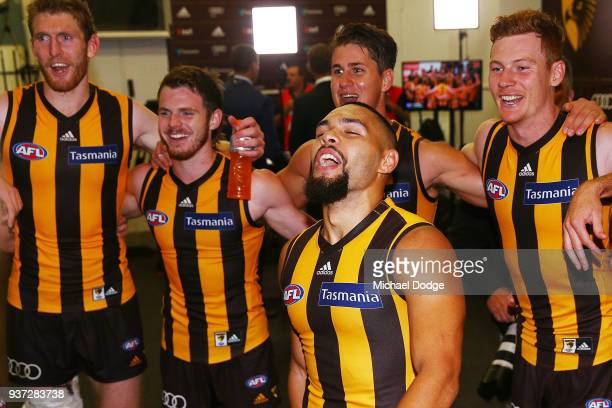 Jarman Impey of the Hawks sing the club song after winning during the round one AFL match between the Hawthorn Hawks and the Collingwood Magpies at...