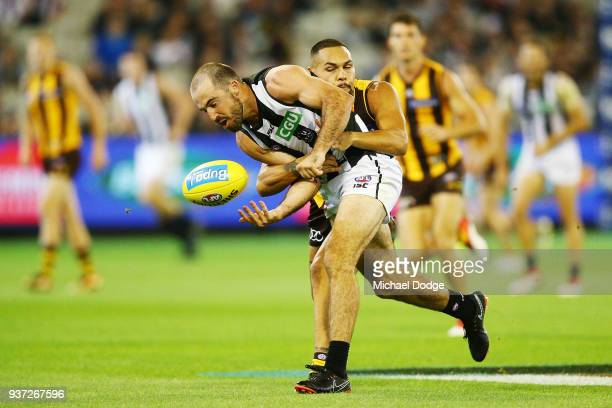 Jarman Impey of the Hawks tackles Steele Sidebottom of the Magpies during the round one AFL match between the Hawthorn Hawks and the Collingwood...