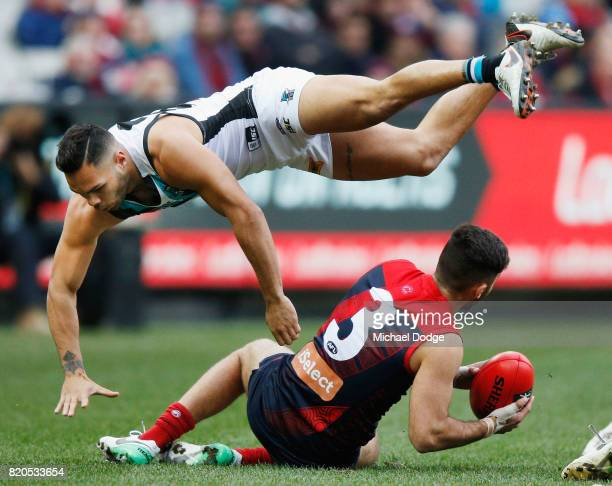 Jarman Impey of the Power collides over Christian Salem of the Demons during the round 18 AFL match between the Melbourne Demons and the Port...