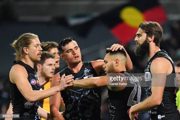 Jarman Impey of the Power is congratulated by his team mates after kicking a goal during the round 11 AFL match between the Port Adelaide Power and...