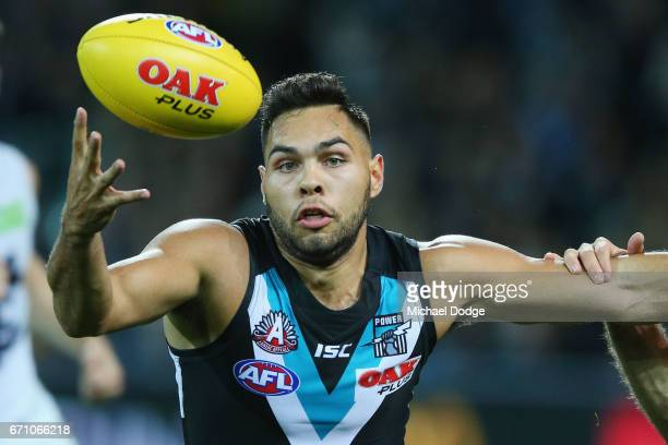 Jarman Impey of the Power is tackled by Kade Simpson of the Blues during the round five AFL match between the Port Adelaide Power and thew Carlton...