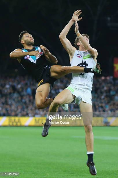 Jarman Impey of the Power leaps for the ball over Lachie Plowman of the Blues during the round five AFL match between the Port Adelaide Power and...