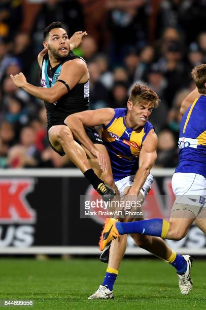 Jarman Impey of the Power snaps for goal over Brad Sheppard of the Eagles and misses during the AFL First Elimination Final match between Port...