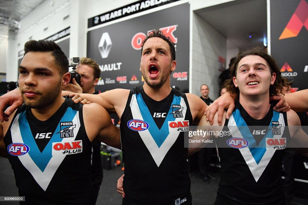 Jarman Impey, Travis Boak and Darcy Byrne-Jones of the Power sing the club song after defeationg the Magpies during the round 21 AFL match between Port Adelaide Power and the Collingwood Magpies at Adelaide Oval on August 13, 2017 in Adelaide, Australia.