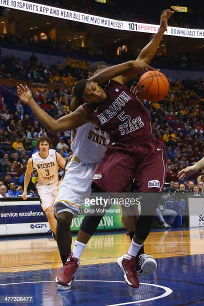 Jarmar Gulley of the Missouri State Bears is hit in the head by a player from the Wichita State Shockers while going for a rebound during the MVC...