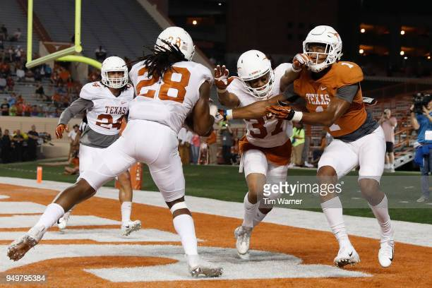 Jarmarquis Durst of the Texas Longhorns intercepts a pass intended for John Burt in the fourth quarter during the OrangeWhite Spring Game at Darrell...