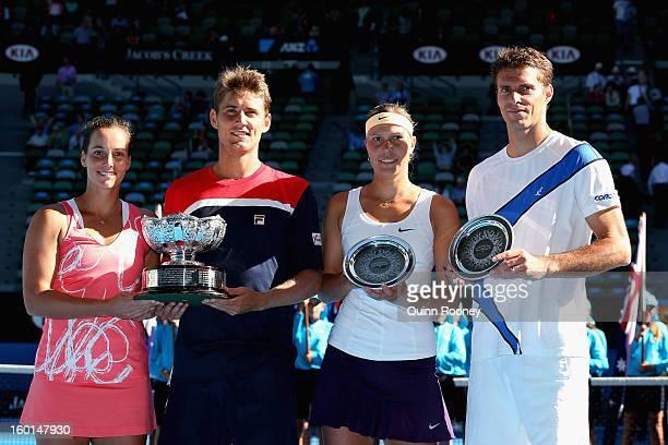 Jarmila Gajdosova and Matthew Ebden of Australia pose with the championship trophy alongside Lucie Hradecka and Frantisek Cermak of the Czech...