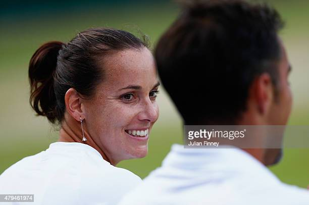 Jarmila Gajdosova of Australia and Nenad Zimonjic of Serbia in action during the Mixed Doubles match against Bob Bryan of USA and Caroline Garcia of...