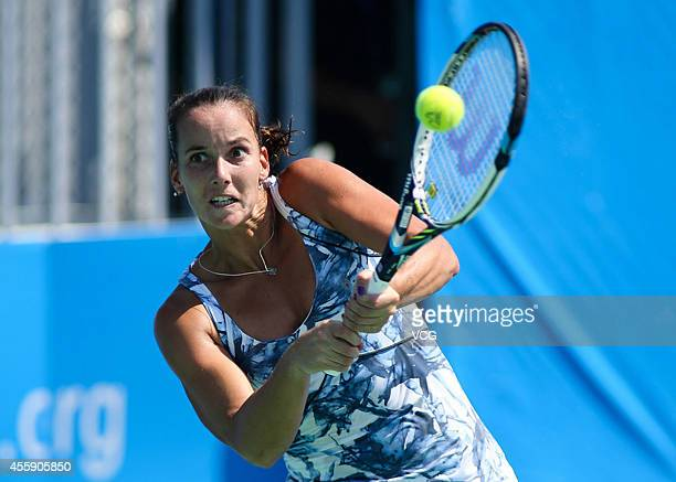 Jarmila Gajdosova of Australia competes with Flavia Pennetta of Italy during day two of the 2014 Dongfeng Motor Wuhan Open at Optics Valley...