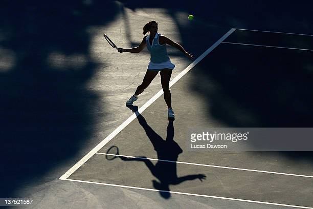 Jarmila Gajdosova of Australia plays a forehand in her first round mixed doubles match with Bruno Soares of Brazil against Sara Errani of Italy and...