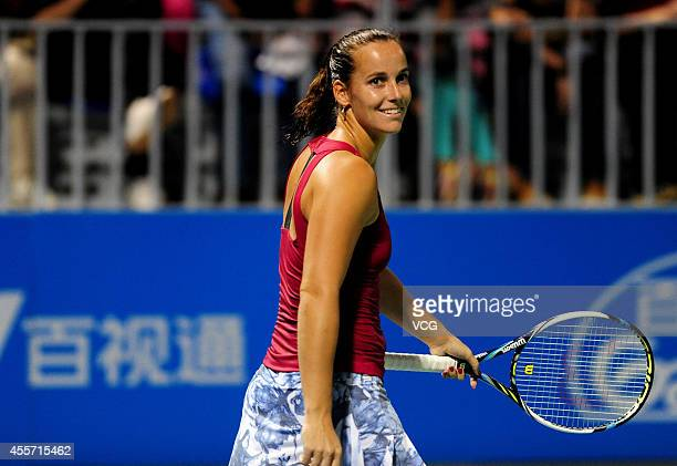 Jarmila Gajdosova of Australia reacts in the qualifying match against Lauren Davis of the United States prior to the start of 2014 WTA Wuhan Open at...