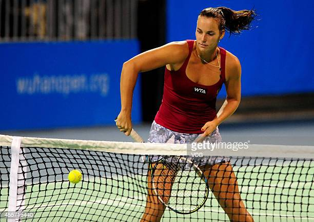 Jarmila Gajdosova of Australia returns a ball in the qualifying match against Lauren Davis of the United States prior to the start of 2014 WTA Wuhan...
