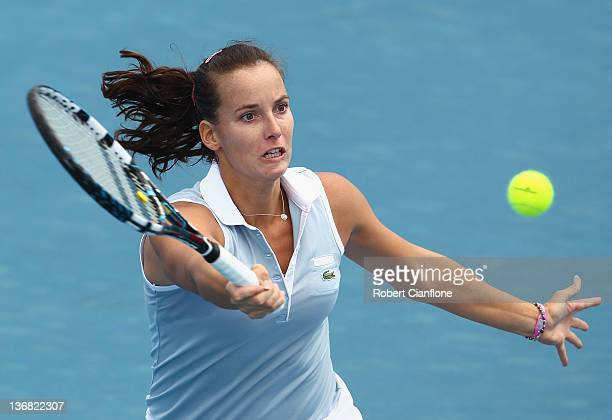 Jarmila Gajdosova of Australia returns a shot to Mona Barthel of Germany during day five of the 2012 Hobart International at Domain Tennis Centre on...