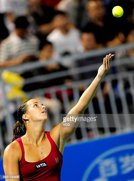 Jarmila Gajdosova of Australia serves in the qualifying match against Lauren Davis of the United States prior to the start of 2014 WTA Wuhan Open at...
