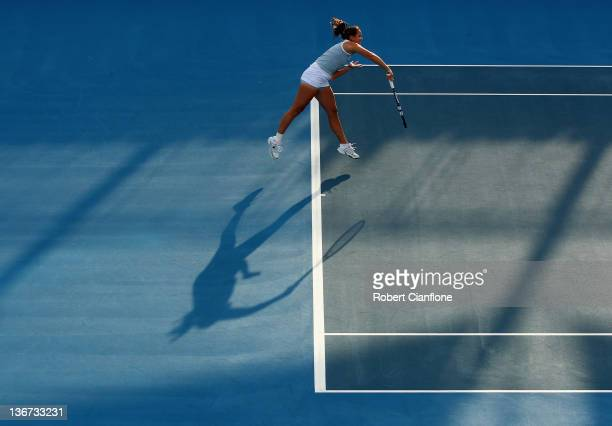Jarmila Gajdosova of Australia serves to Anastasia Rodionova of Australia during day three of the 2012 Hobart International at Domain Tennis Centre...