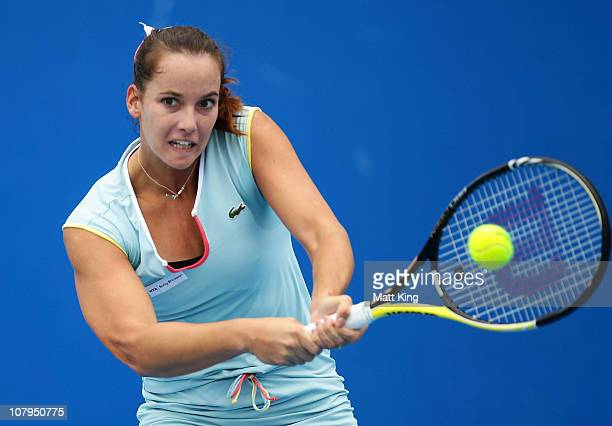 Jarmila Groth of Australia plays a backhand during her 1st round match against Johanna Larsson of Sweden during day two of the Moorilla Hobart...