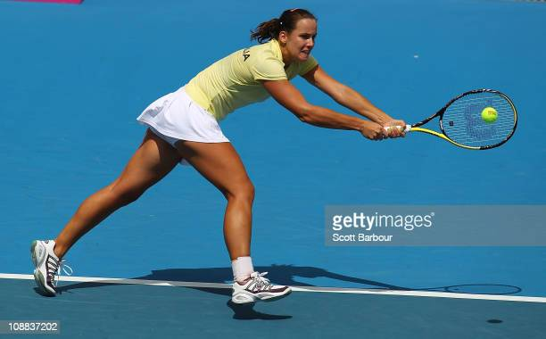 Jarmila Groth of Australia plays a backhand during her match against Francesca Schiavone of Italy during day one of the Federation Cup tie between...