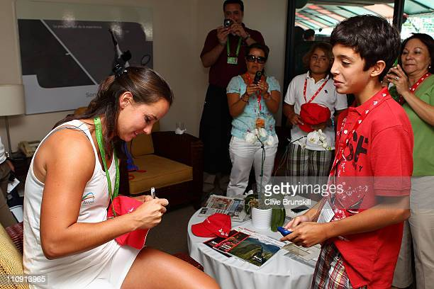 Jarmila Groth of Australia signs autographs for fans during the Sony Ericsson Open at Crandon Park Tennis Center on March 26 2011 in Key Biscayne...