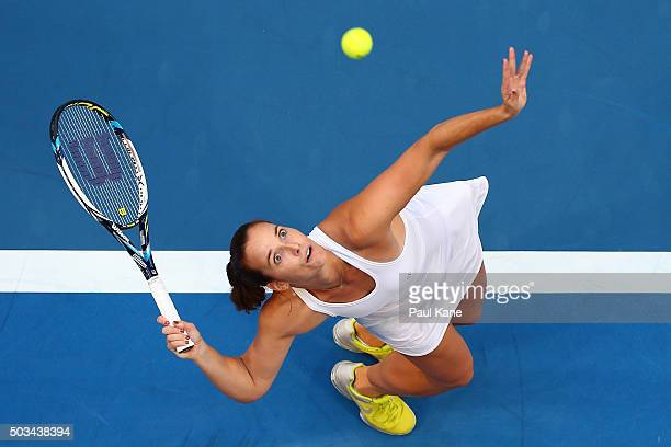 Jarmila Wolfe of Australia Gold serves to Serena Williams of the United States in her singles match during day three of the 2016 Hopman Cup at Perth...
