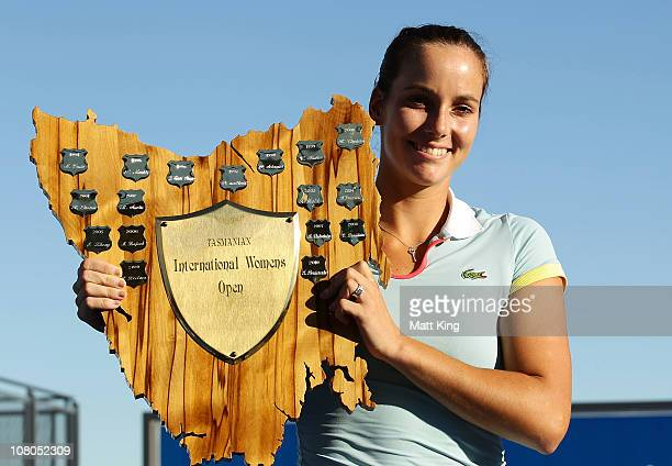 Jarmilla Groth of Australia poses with the winners trophy after winning the Women's singles final match against Bethanie MattekSands of USA during...
