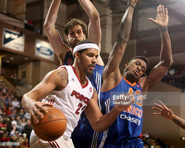 Jarnell Stokes from the Sioux Falls Skyforce drives past Jordan Bachynski and Thanasis Antetokounmpo from the Westchester Knicks during their NBA...