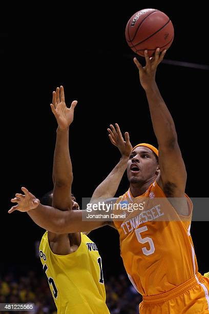 Jarnell Stokes of the Tennessee Volunteers shoots the ball against Jon Horford of the Michigan Wolverines during the regional semifinal of the 2014...