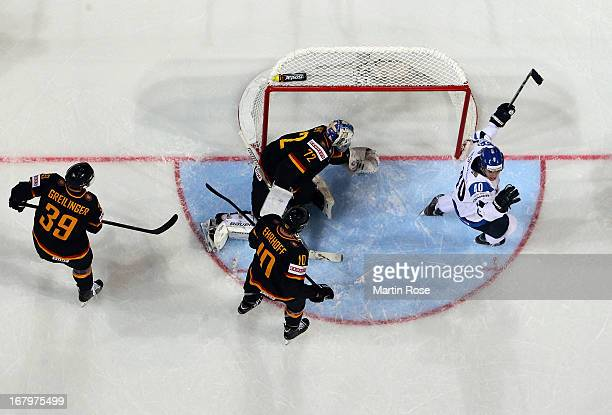 Jarno Koskiranta of Finland celebrates after he scores his team's 2nd goal over Rob Zepp goaltender of Germany during the IIHF World Championship...